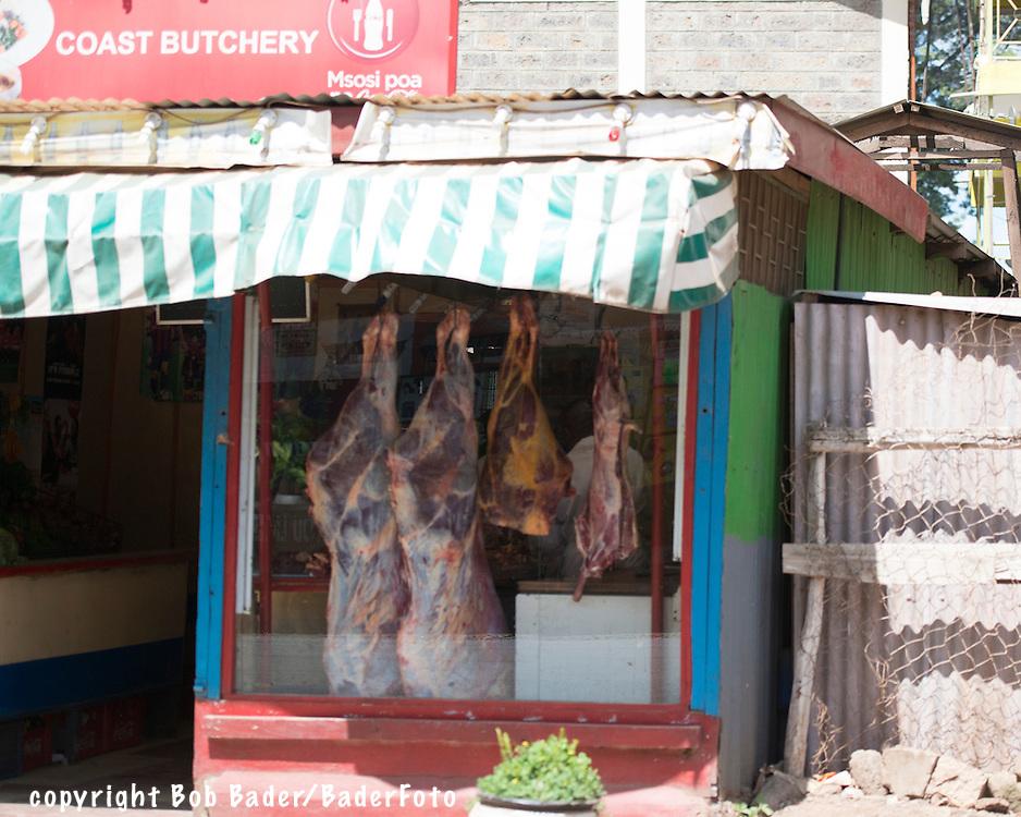 Beef and lamb hanging in the window of a Kibera Slum Butcher Shop in Nairobi Kenya