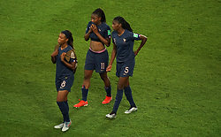France's Grace Geyoro (left) Kadidiatou Diani and Aissatou Tounkara react after the final whistle