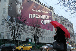 March 27, 2019 - Kiev, Ukraine - A woman passes by a pre-election billboard of Ukrainian presidential candidate and current Ukrainian President Petro Poroshenko with slogan 'There are many candidates - the President is one!', in central Kiev. The presidential elections will take place in Ukraine on 31 March 2019. (Credit Image: © Serg Glovny/ZUMA Wire)