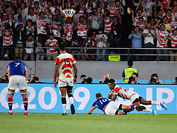 Japan's Kotaro Matsushima scores his sides second try during the Pool A match between Japan and Russia at the Tokyo Stadium, Tokyo, Japan. Picture date: Friday September 20, 2019. See PA story RUGBYU Japan. Photo credit should read: Ashley Western/PA Wire. RESTRICTIONS: Editorial use only. Strictly no commercial use or association. Still image use only. Use implies acceptance of RWC 2019 T&Cs (in particular Section 5 of RWC 2019 T&Cs) at: https://bit.ly/2knOId6
