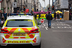 Hundreds of environmental protesters from Extinction Rebellion occupy Oxford Circus, a pink yacht being the focal point of their presence, with traffic denied access to two of London's busiest streets. London, April 16 2019.