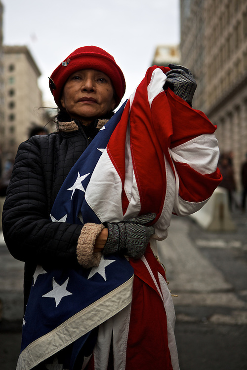 """Alida Yath, arrived to the with her own American flag for the inauguration parade for Pres. Barack Obama on January 21, 2013 in Washington, D.C. Yath, originally from Guatemala, became a U.S. citizen in August specifically so she could vote for Pres. Obama. """"I want better immigration laws, affordable education, health care and no more weapons,"""" Yath said."""