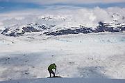 Dr. Tad Pfeffer, a glaciologist at the University of Colorado, photographs the Columbia Glacier, near Valdez, Alaska.