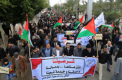 January 2, 2018 - Gaza City, Gaza Strip, Palestinian Territory - Palestinian employees of Gaza strip hold banners and Palestine flags during a demonstration demanding their rights, in Gaza city, on January 2, 2018  (Credit Image: © Atia Darwish/APA Images via ZUMA Wire)