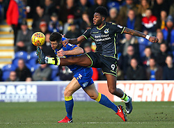 Ellis Harrison of Bristol Rovers challenges Jonathan Meades of AFC Wimbledon - Mandatory by-line: Robbie Stephenson/JMP - 17/02/2018 - FOOTBALL - Cherry Red Records Stadium - Kingston upon Thames, England - AFC Wimbledon v Bristol Rovers - Sky Bet League One