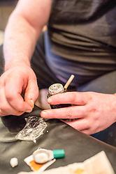 Preparing crack cocaine to smoke