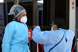 JOHANNESBURG, SOUTH AFRICA - JULY 03: Health officials at the Nasrec quarantine on July 03, 2020 in Johanneburg, South Africa. Gauteng MEC Dr Bandile Masuku visited the NASREC Quarantine Site to inspect facilities and monitor patient care experience. The site became operational on June 15. (Photo by Gallo Images/Dino Lloyd)