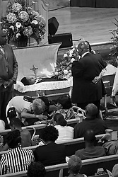 03 June 2014. New Orleans, Lousiana. <br /> Grief stricken friends and relatives attend the funeral for teenage shooting victim Dwayne Matthew Joseph at the Franklin Avenue Baptist Church. 17 year old Joseph was shot and killed following an altercation in the street May 26th. Raised by his great grandmother Catherine Robinson, family and friends confirmed Dwayne was a good kid who went to church, looked after his younger siblings and had never been in trouble with the law. Dwayne's older brother Damien preceded him in death. He too was shot dead in February 2011 aged just 19 years.<br /> Photo; Charlie Varley/varleypix.com