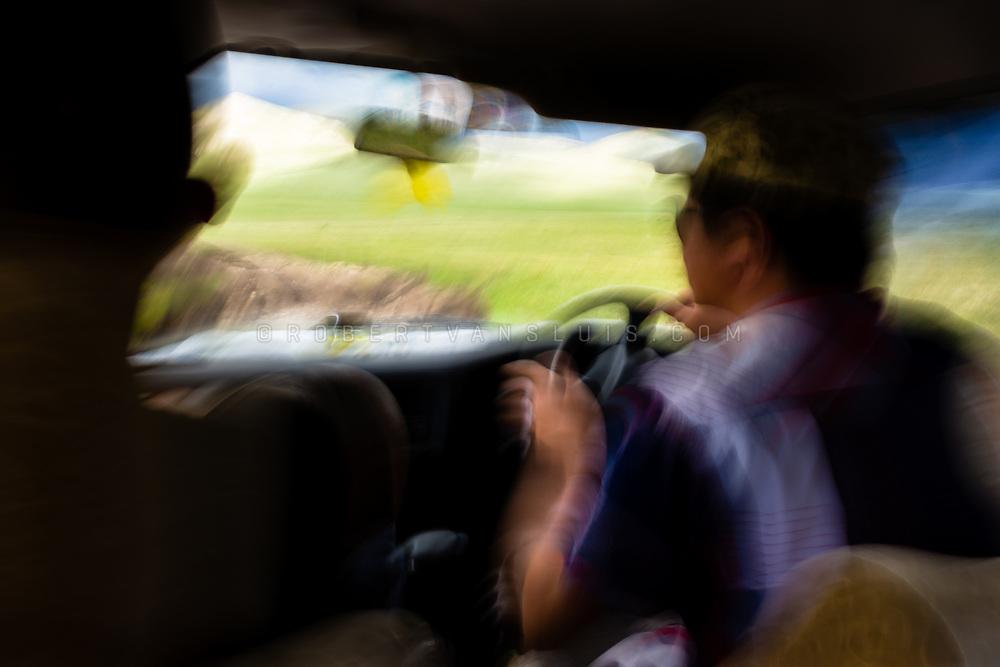Driving a four-wheel (4WD) jeep across muddy roads in Khövsgöl Province, Mongolia. Photo © Robert van Sluis