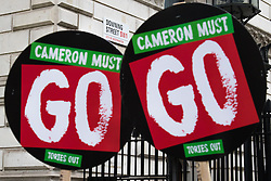 "London, April 16th 2016. Placards outside Downing Street demand that ""Cameron must go!""  as thousands of people supported by trade unions and other rights organisations demonstrate against the policies of the Tory government, including austerity and perceived favouring of ""the rich"" over ""the poor""."