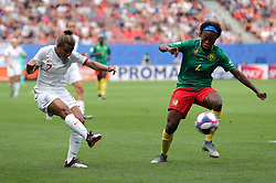 England's Nikita Parris (left) and Cameroon's Yvonne Leuko during the FIFA Women's World Cup, round of Sixteen match at State du Hainaut, Valenciennes.