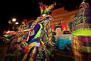 A costumed reveler from Bolivia dances in the streets during the Carnaval de Ponce February 21, 2009 in Ponce, Puerto Rico. Vejigantes are a folkloric character representing the devil.