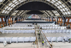 © Licensed to London News Pictures. 09/04/2020. Manchester, UK. The National Health Service is building a 648 bed field hospital for the treatment of Covid-19 patients , at the historical railway station terminus which now forms the main hall of the Manchester Central Convention Centre . The facility is due to open on Easter Monday , 13th April 2020 , and will treat patients from across the North West of England , providing them with general medical care and oxygen therapy after discharge from Intensive Care Units . Photo credit: Joel Goodman/LNP