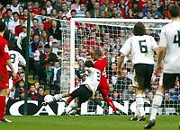 Fotball<br /> VM-kvalifisering<br /> Wales v Østerrike<br /> 26. mars 2005<br /> Foto: Digitalsport<br /> NORWAY ONLY<br /> Martin Stranzl of Austria scores their second goal despite the attentions of Danny Gabbidon and goalkeeper Danny Coyne