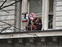 © Licensed to London News Pictures. 30/11/2011, London, UK. Offcie workers hold banners from windows in Northumberland Avenue, London. Up to two million public sector workers are staging a strike over pensions in what is set to be the biggest walkout for a generation. Photo credit : Stephen Simpson/LNP