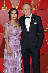 Salma Hayek and François-Henri Pinault walking on the red carpet during the 90th Academy Awards ceremony, presented by the Academy of Motion Picture Arts and Sciences, held at the Dolby Theatre in Hollywood, California on March 4, 2018. (Photo by Sthanlee Mirador/Sipa USA)