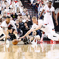 25 April 2016: Portland Trail Blazers guard Damian Lillard (0) vies for the loose ball with Los Angeles Clippers guard Austin Rivers (25) and Portland Trail Blazers center Mason Plumlee (24) during the Portland Trail Blazers 98-84 victory over the Los Angeles Clippers, during Game Four of the Western Conference Quarterfinals of the NBA Playoffs at the Moda Center, Portland, Oregon, USA.