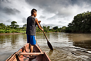 An Embera boatman navigates his piragua on the Rio Sambu in the Darien Province, Panama