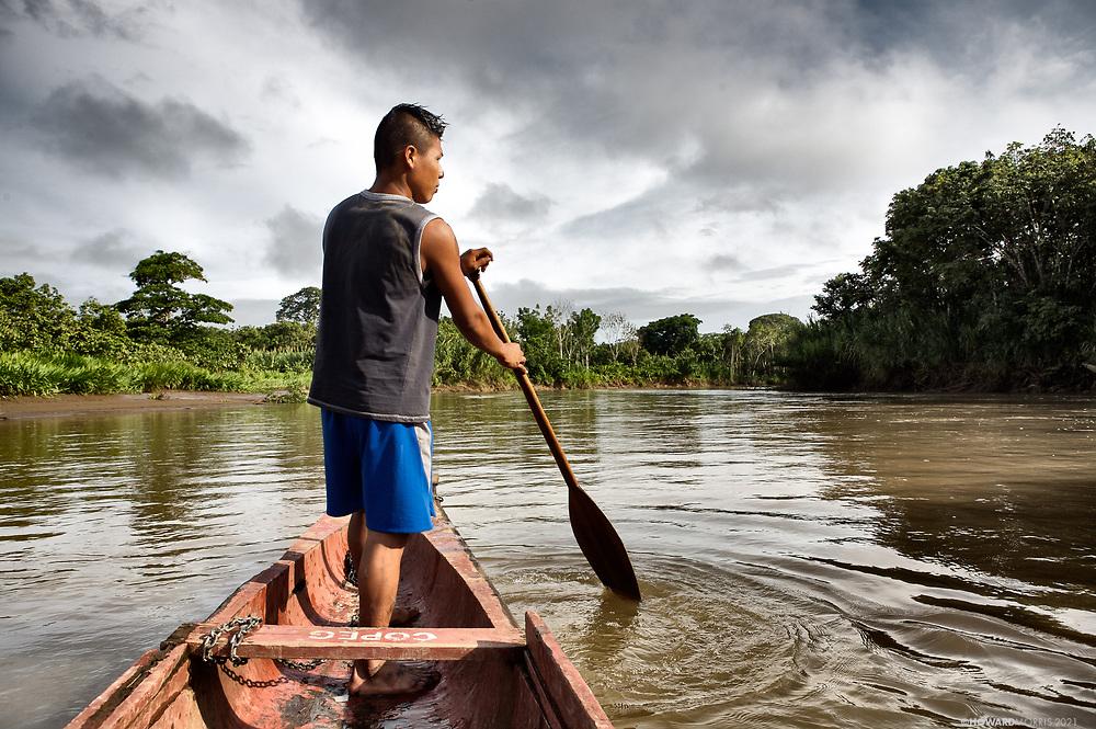 An Embera boatman navigates his piragua on the Rio Sambu in the Darien Province, Panama