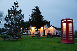 © Licensed to London News Pictures. 12/12/2019. Baxterley, North Warwickshire, UK. The Rose Inn, a typical English pub with duck pond, Christmas tree and telephone box pub being used as a polling station. Photo credit: Dave Warren/LNP