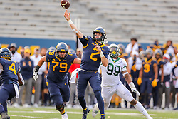 Oct 3, 2020; Morgantown, West Virginia, USA; West Virginia Mountaineers quarterback Jarret Doege (2) throws a pass for a touchdown to wide receiver Bryce Ford-Wheaton (0) during the first overtime against the Baylor Bears at Mountaineer Field at Milan Puskar Stadium. Mandatory Credit: Ben Queen-USA TODAY Sports