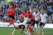Fulham's Kieran Richardson © throws his body in the way to block a shot from Cardiff's Fraizer Campbell (l). Barclays Premier league, Cardiff city v Fulham at the Cardiff city Stadium in Cardiff , South Wales on Sat 8th March 2014. pic by Andrew Orchard, Andrew Orchard sports photography