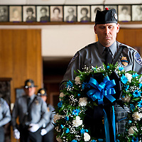 051413       Brian Leddy<br /> Gallup Police Officer Kelly Akeson carries a wreath during a Fallen Officer's Memorial Service Tuesday at the Elk's Lodge. The service remembered six officers who were killed in the line of duty while working for the Gallup Police Department.