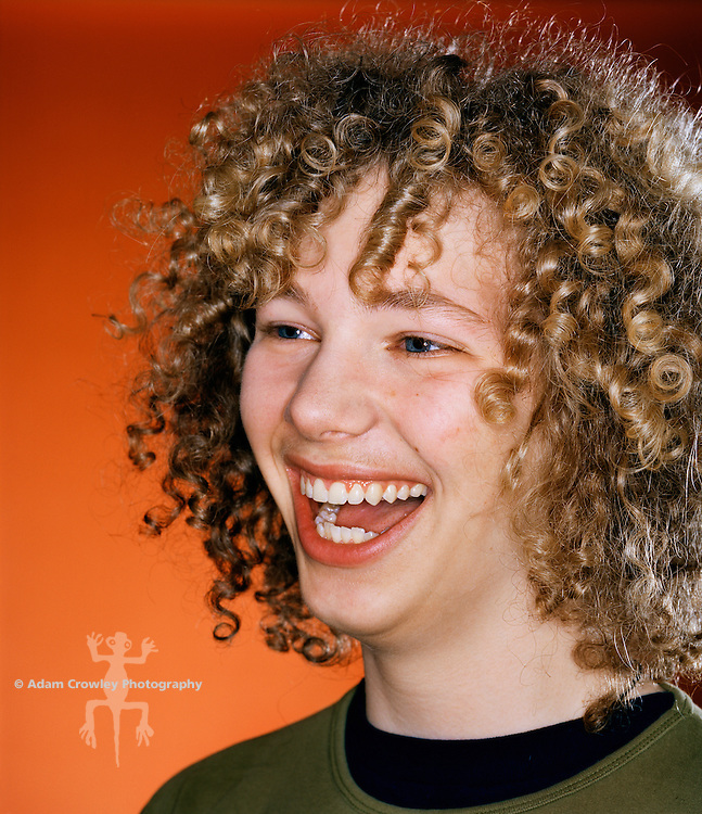 Male teenager (18 years old) smiling, close-up.