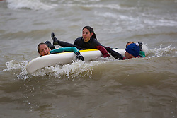 Brighton, UK. 19/11/2016, Members of the Brighton Surf Life Saving Club take part in their weekly class while powerful waves are hitting the beach. Brighton is preparing for Superstorm Angus to hit overnight with torrential rain and powerful gusts of wind. Photo Credit: Hugo Michiels