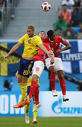 SAINT PETERSBURG, July 3, 2018  Ola Toivonen (L) of Sweden competes for a header with Granit Xhaka (C) and Manuel Akanji of Switzerland during the 2018 FIFA World Cup round of 16 match between Switzerland and Sweden in Saint Petersburg, Russia, July 3, 2018. (Credit Image: © Cao Can/Xinhua via ZUMA Wire)