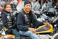 Robert and Todd Bearshield on Main Street during the 75th Annual Sturgis Black Hills Motorcycle Rally.  SD, USA.  August 4, 2015.  Photography ©2015 Michael Lichter.