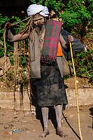 A sadhu walking along a road in Agra, Uttar Pradesh, India.