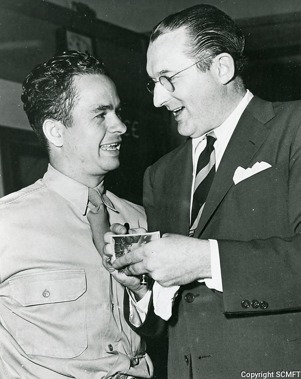 1943 Tommy Dorsey signs an autograph for a soldier at the Hollywood Canteen.