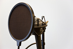 Close up of a microphone and pop filter
