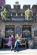 Two ladies drink Guinness at The Brazen Head in Merchants Quay on 07th April 2017 in Dublin, Republic of Ireland. The Brazen Head pub dates back to 1198. Dublin is the largest city and capital of the Republic of Ireland.