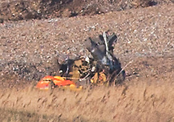 © Licensed to London News Pictures. 08/01/2013. Cley Next to Sea, UK. Part of the crashed helicopter. The scene where a US Force (USAF) helicopter crashed on marshland on Cley Next to Sea, Norfolk. Four people are believed to have died when the  HH-60G Pave Hawk helicopter came down over a nature reserve while on a training exercise. Photo credit : Terry Harris/LNP