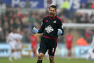 Lukasz Fabianski, the Swansea goalkeeper shows his delight as he celebrates after Andre Ayew scores the 3rd goal. Barclays Premier league match, Swansea city v Liverpool  at the Liberty Stadium in Swansea, South Wales on Sunday 1st May 2016.<br /> pic by  Andrew Orchard, Andrew Orchard sports photography.