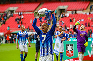 Chertsey Town's Lubomir Guentchev (7) lifts the cup during the FA Vase final match between Chertsey Town and Cray Valley at Wembley Stadium, London, England on 19 May 2019.