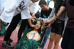 May 24, 2017 - Hangzhou, Hangzhou, China - Hangzhou, CHINA-May 24 2017: (EDITORIAL USE ONLY. CHINA OUT)..Hundreds of college students take graduation photos in Chinese dumpling style in Hangzhou, east China's Zhejiang Province, marking the upcoming Dragon Boat Festival and graduation. (Credit Image: © SIPA Asia via ZUMA Wire)