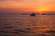 Luminous orange sunset reflected on the water New York City