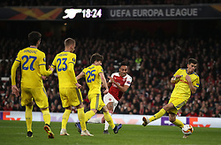 Arsenal's Pierre-Emerick Aubameyang (centre) shoots towards goal during the UEFA Europa League round of 32 second leg match at the Emirates Stadium, London.