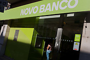 A customer uses an indoor ATM from Novo Banco, on 14th July 2016, in Lisbon, Portugal. Novo Banco is a Portuguese bank introduced on 4 August 2014 by the Bank of Portugal to rescue assets and liabilities of Banco Espírito Santo.
