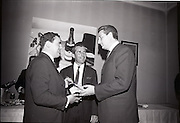 24/06/1965<br /> 06/24/1965<br /> 24 June 1965<br /> Gilbeys Ireland Ltd. reception at Gilbey's Wine Merchants, Nos. 46-49 O'Connell St., Dublin, for the presentation of a consignment of Dry Monopole Champagne to the organisers of Le Bal des Petits Lits Blancs. Image shows Mr. David I. Dand (left), Director, Gilbeys of Ireland Ltd. handing over the Champagne to M. Rene Lambert, Chairman, Organising Committee of the ball. In centre is Mr. Ian Cairnduff, Director of Gilbeys.