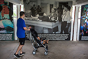 2015/11/21 - Puerto Triunfo, Colombia: A visitor looks to photograph where the mother of Pablo Escobar identify him after he was killed. The only place that the name of the previous owner of Hacienda Nápoles is mentioned is on what is called the Museum of Memory, where it is shown the victims and terrorist acts perpretated by Pablo Escobar and the Medellín Cartel. The Hacienda Nápoles was a 20sq kilometer property own by drug lord Pablo Escobar. In its splendor, the property had its own private airport, bull arena, kart racing circuit and even a private zoo that included many kinds of animals from different continents such as giraffes, ostriches, elephants, hippopotamuses, antelope, and exotic birds. After the death of Pablo Escobar in 1993, the family went into a legal struggle with the Colombian government over the property. Nowadays it is an leisure park, where most of Escobar presence disappeared. (Eduardo Leal)