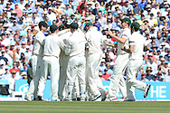 Australian players celebrate and congratulate Peter Siddle of Australia for the wicket of Adam Lyth of England for 10 during the 3rd day of the Investec Ashes Test match between England and Australia at the Oval, London, United Kingdom on 22 August 2015. Photo by Phil Duncan.