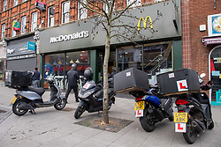 © Licensed to London News Pictures. 13/05/2020. London, UK. Motorbikes parked outside the Harrow McDonald's store. McDonald's has reopened 15 stores in the south east for delivery only service through Uber Eats. Photo credit: Peter Manning/LNP
