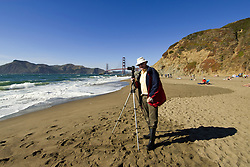 San Francisco: Photographer Lee Foster at Baker Beach with Golden Gate Bridge in background.  Photo # 2-casanf83737.  Photo copyright Lee Foster