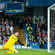 Chelsea goalkeeper Thibaut Courtois concedes after getting caught off his line by Stoke City midfielder Charlie Adam during the Barclays Premier League match between Chelsea and Stoke City at Stamford Bridge, London. April 4, 2015.<br /> <br /> Picture by Jack Megaw/Focus Images Ltd <br /> +44 7481 764811<br /> jack@jackmegaw.com<br /> 04/04/2015