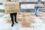 Members of 'Names Not Numbers' stage a demonstration with a display of placards naming people who have died from COVID-19 outside Downing Street in London on Wednesday, Oct 14, 2020. The UK has recorded 12,872 more coronavirus cases and 65 deaths in the latest daily government update. It marks a slight fall from last Saturday when 15,166 cases and 81 deaths were recorded. The UK's coronavirus death toll now stands at 42,825. (VXP Photo/ Vudi Xhymshiti)