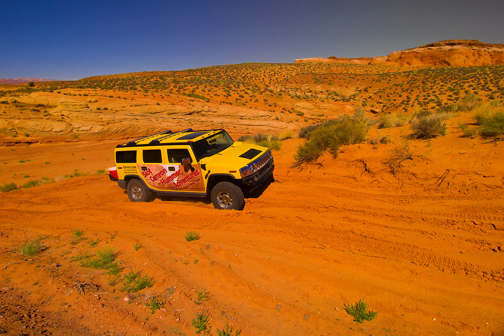 Slot Canyon Hummer Adventures tour into the Secret Canyon (slot canyon), near Page, Arizona USA